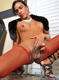 Shemale hottie in red stockings plays solo