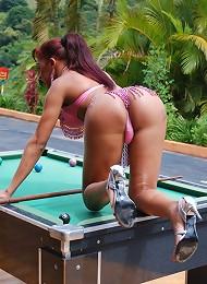 Sexy T-girl sticks pool ball in ass